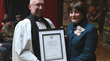 Chaplain George Jamiec, of Mildenhall and District Sea Cadet Corps, receiving his award from Lord Li