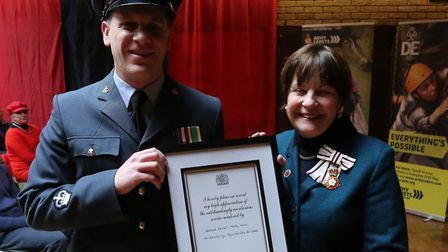 Warrant Officer Mark Ellis of 188 ( Ipswich) Squadron, Royal Air Force Cadets, receiving his award f