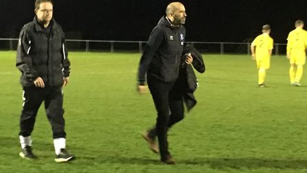 Walsham-le-Willows new manager Trevor Collins, left, and Bury Town boss Ben Chenery walk towards the