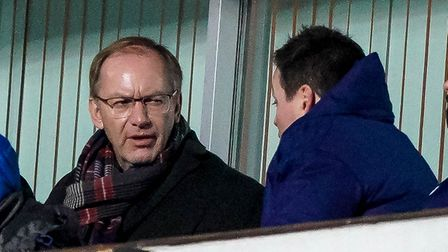 Ipswich Town owner Marcus Evans talks with manager of football operations Lee O'Neill during the Lin