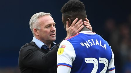 Ipswich Town manager Paul Lambert (left) and Toto Nsiala during the Sky Bet Championship match at Po