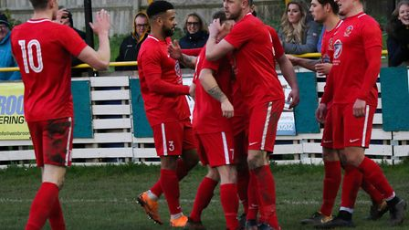 Stowmarket Town players celebrate a goal during their impressive 3-0 win at Stanway Rovers. Picture:
