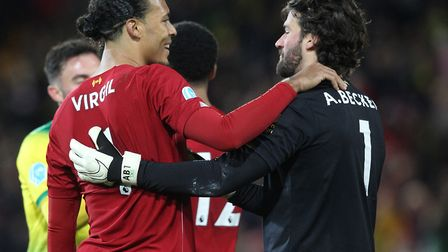Liverpool's Virgil van Dijk and Alisson Becker celebrate a win at Norwich City. The Anfield club are