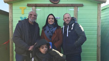 Andy Hodgson (right) has donated a beach hut to disabled boy Tyler Gueizelar (front) after a rogue t
