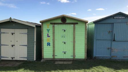 A local man has built a disabled man a new beach hut, after the family's previous one was destroyed