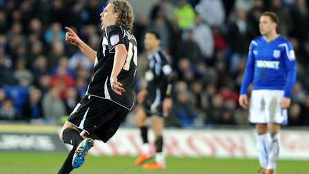 Jimmy Bullard turns to celebrate his second goal at the Cardiff City Stadium, in March, 2011. Pictur