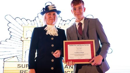 Roz Eminson, High Sheriff of Suffolk, presents a Certificate of Merit to Harry Hall at the 2019 cere