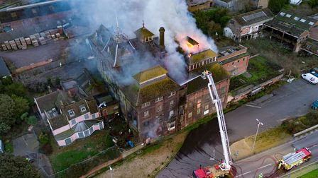 Firefighters on a turntable ladder tackle the flames Picture: Sky Cam East