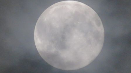 The Super Worm Moon showing through the clouds Picture: ALEX RUDIGER