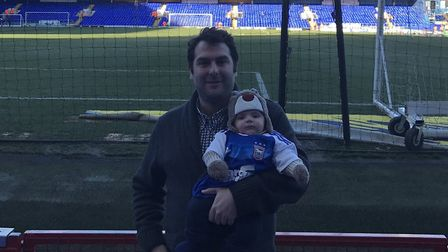 Town fan Joe Fairs and his son Teddy - at Portman Road, obviously! Photo: CONTRIBUTED