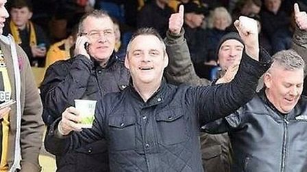 Simon Dobbin, before he was injured, at a Cambridge United match Picture: FAMILY PHOTO