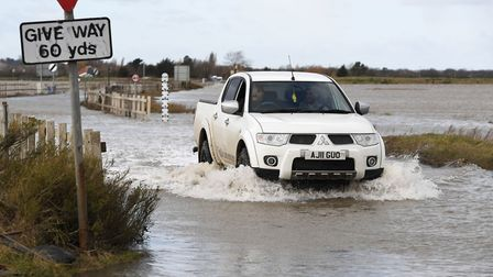Heavy rain made it more difficult that normal to cross The Strood causeway to Mersea Island in Essex
