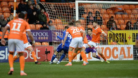 Will Keane forces a second half save from the goalkeeper at Blackpool. Picture Pagepix Ltd