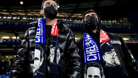 Two fans in the stands wearing face masks prior to the beginning of the FA Cup fifth round match at