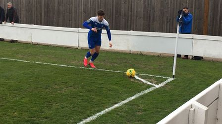 Ross Crane prepares to take a corner, during this afternoon's Isthmian League North clash at Ram Mea