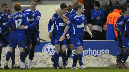 Owen Garvan, centre, is congratulated by Damien Delaney after scoring the winner at Blackpool, in th