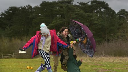 Milly, Ruben and Leo having fun in the wind during Storm Dennis Picture: SARAH LUCY BROWN