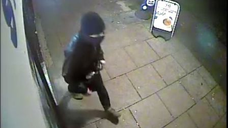 CCTV images of a man police want to speak to in connection with a robbery in Bury St Edmunds Picture