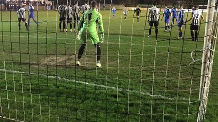 St Ives keeper Martin Conway is ready to defend a first-half free-kick by Leiston. Picture: CARL MAR