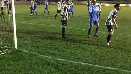 Rob Eagle (blue) waits for a cross in the St Ives penalty area. Picture: CARL MARSTON