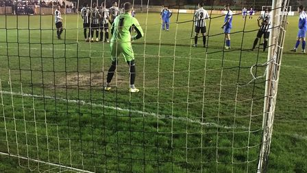 St Ives keeper Martin Conway oragnises his defensive wall as Byron Lawrence prepares to take a free-