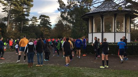 Runners congregate for the start of the Bedford parkrun, with the bandstand close by