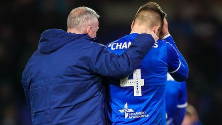 Luke Chambers has his head in his hands as Town manager Paul Lambert puts an arm around his skipper,