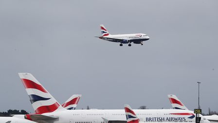 A British Airways plane comes in to land at Heathrow Airport in London as the airline announced that