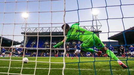 James Norwood beats Peterborough keeper Christy Pym from the spot, for a consolation goal for Town,