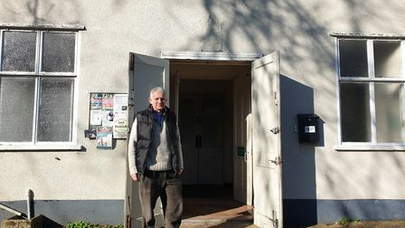 Rector Mark Sanders by the entrance to the current building Picture: ARCHANT