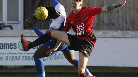 Cruise Nyadzayo, left, and James Chivers battle for the ball during Bury Town's 2-1 win over Histon