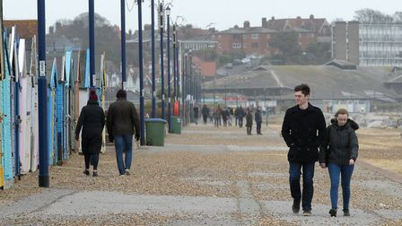 Walkers along the promenade at Felixstowe as Storm Dennis picked up Picture: SARAH LUCY BROWN
