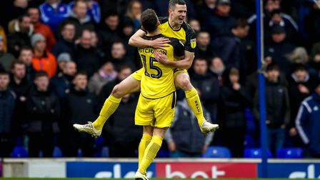 Jamie Murphy celebrates with teammate Reece Hutchinson after giving the visitors an early lead. Pic