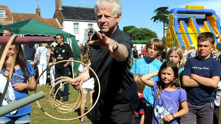 Suffolk scriptwriter Richard Curtis tries his hand at the hoop challenge at the Walberswick Fete