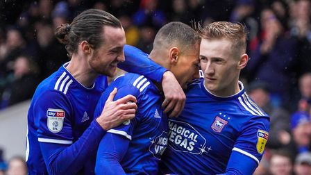 Will Keane (left) and Flynn Downes (right) celebrate with Kayden Jackson after he had scored to give
