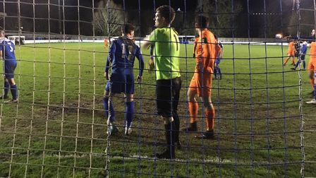 Bury Town keeper Ben Mayhew and his defence prepare to deal with a Maldon & Tiptree corner. Picture:
