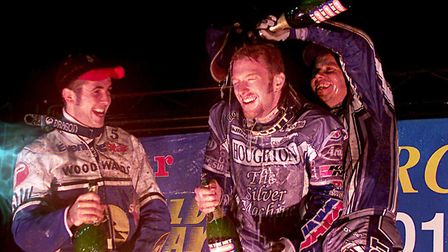 Jason Crump (centre) celebrates his win with Nicki Pedersen (right) who finished third, as second pl