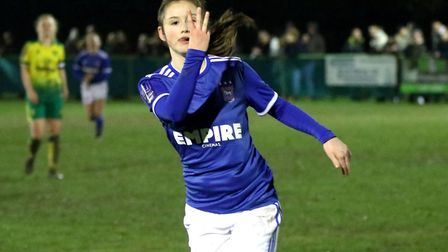 Teenager Eloise King celebrates her hat-trick as Town Women won 10-0 at Norwich in their third East