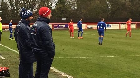 The Needham Market mamagement team of assistant Tom Rothery (red hat) and manager Kevin Horlock (blu