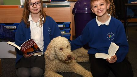 Lyra and Lewis spending time with Betty whilst reading their books at Woodhall Primary Picture: CHA