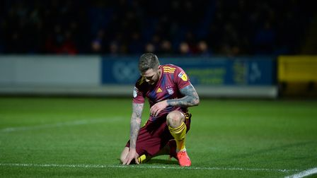 James Norwood and Town were disappointing at Wimbledon - not that Karl Fuller could see! Picture: PA