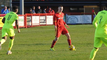 Needham Market teenager, Noah Collard, on the ball during the recent 4-3 win over Hednesford, has si