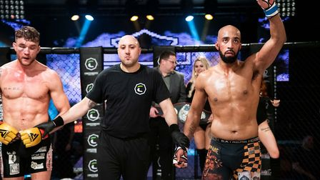 Jahreau Shepherd has his hand raised after winning the welterweight title at Contenders 29. Picture:
