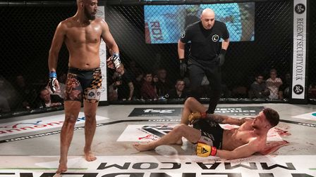 Jay Shepherd, left, looks down on a bloodied Quinten DeVreught during their title fight at Contender