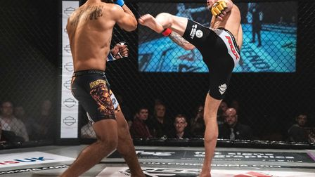 Quinten DeVreught throws a head kick at Jay Shepherd during their title fight at Contenders 29. Pict
