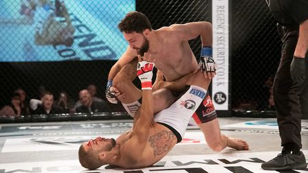 Javid Basharat lands some ground and pound on the way to victory in his bantamweight title defence a