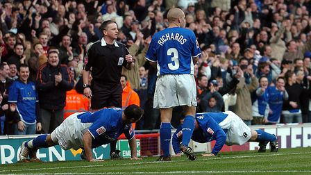 Tommy Miller and Shefki Kuqi do press-ups in front of the North Stand to celebrate the latter's goal