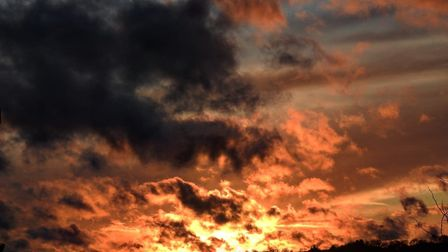 """Stunning sunset made the sky """"look like it was on fire"""" in Great Cornard. Picture: JOHN FITCH"""
