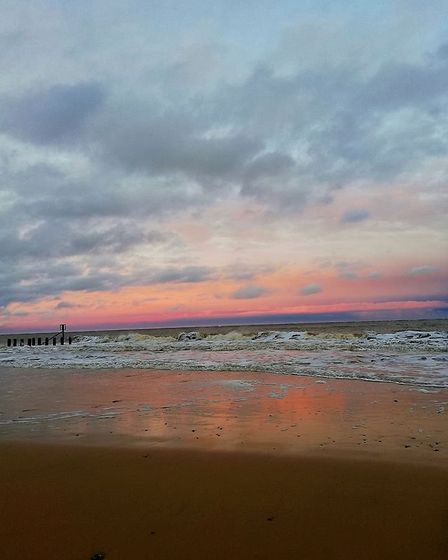 Stunning colours and reflections at Lowestoft beach on Sunday evening. Picture: JENNIFER POWLES