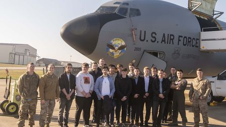 Engineering students and instructors from West Suffolk College with airmen next to a KC-135 Stratota